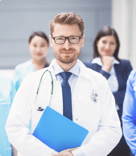 Physician holding compensation documents